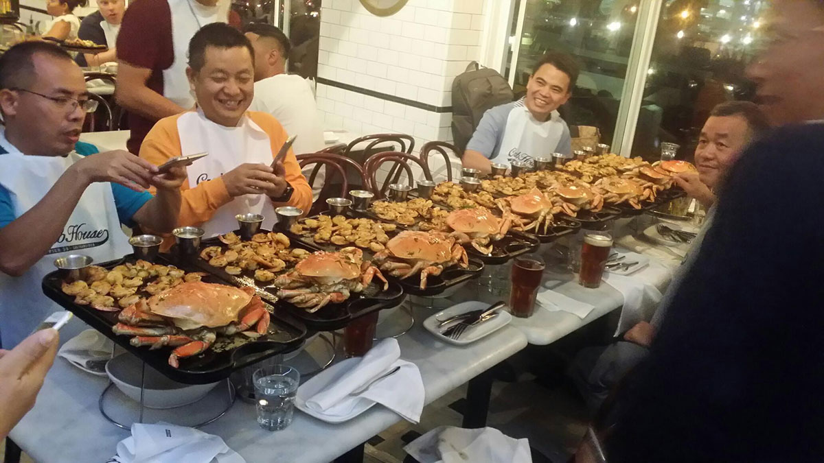 People enjoying Crab and Shrimp